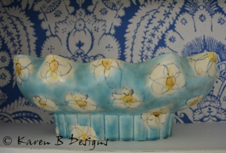 This has a modern look about it with its hand painted flowers, but it is from the 1940's.