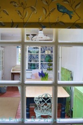 Looking out to the utility room from my galley kitchen door. The light is an old industrial shade from a factory, the desk was picked up for me from a chateau in France by a builder friend who was working there. The aqua chairs are garden furniture with cushion seat pads. The table is farmhouse in style with two big drawers and I 'pickled' and varnished the top to get rid of the yellow pine colour. All the painted furniture was underpainted in a colour designed to show through when the top colur was sanded back in places to give a distressed look.