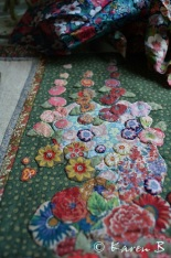 When properly sewn on and the tacking stitches are removed, each little flower plumps up and begins to look more real.