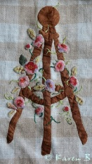 Applique work comes alive when embroidered leaves and tendrils are added