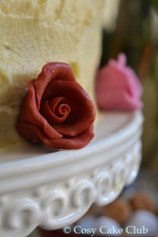 Rose buds adorn the Red Velvet Cake